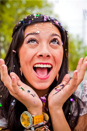 A young girl with confetti in her hair. Stock Photo - Premium Royalty-Free, Code: 6106-06114660