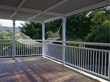 Hammock hanging in verandah with view. Stock Photo - Premium Royalty-Free, Code: 6106-06114766
