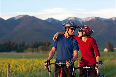 Cyclist couple share a laugh Stock Photo - Premium Royalty-Free, Code: 6106-06114706