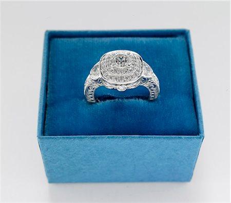 expensive jewelry - Diamond Ring in Blue Box Stock Photo - Premium Royalty-Free, Code: 6106-06308278