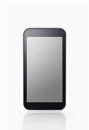 Smartphone on White background Stock Photo - Premium Royalty-Free, Code: 6106-06308459