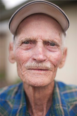Close-up portrait senior man Stock Photo - Premium Royalty-Free, Code: 6106-06308693