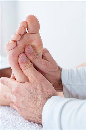 foot massage - Physiotherapist at work Stock Photo - Premium Royalty-Free, Code: 6106-06308852