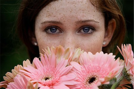 smelling - Close up of young woman smelling daisies Stock Photo - Premium Royalty-Free, Code: 6106-06309278