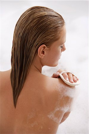 Young woman in bubble bath Stock Photo - Premium Royalty-Free, Code: 6106-06309358