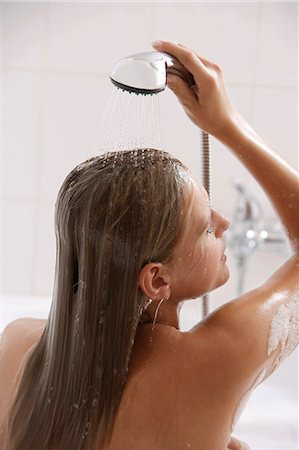 Young woman in shower Stock Photo - Premium Royalty-Free, Code: 6106-06309361