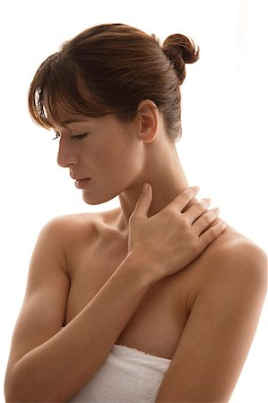 Woman with hand on neck Stock Photo - Premium Royalty-Free, Code: 6106-06309674