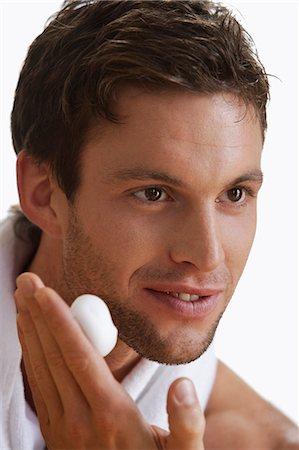 shirtless men - Young man applying shaving foam Stock Photo - Premium Royalty-Free, Code: 6106-06309762