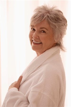 pretty - Older woman in robe smiling. Stock Photo - Premium Royalty-Free, Code: 6106-06309784