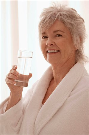 drinking water glass - Older woman drinking water. Stock Photo - Premium Royalty-Free, Code: 6106-06309786