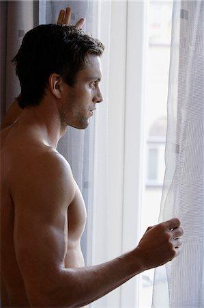 shirtless men - Profile of man looking out window Stock Photo - Premium Royalty-Free, Code: 6106-06309736