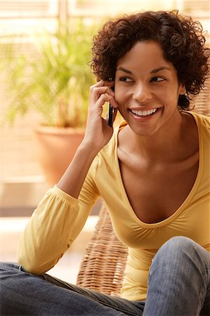 Woman talking on phone and smiling. Stock Photo - Premium Royalty-Free, Code: 6106-06309990