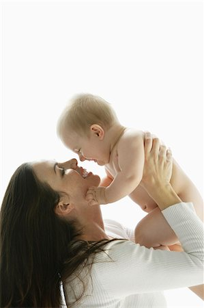 mother and baby looking at each other Stock Photo - Premium Royalty-Free, Code: 6106-06309994