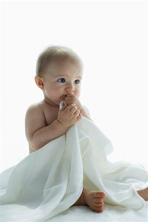 shy baby - nude baby holding blanket Stock Photo - Premium Royalty-Free, Code: 6106-06310002