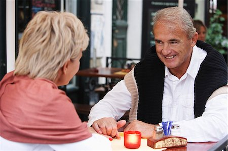 mature couple having a candle lit dinner Stock Photo - Premium Royalty-Free, Code: 6106-06310101