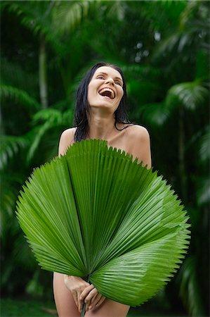 naked woman behind big tropical leaf Stock Photo - Premium Royalty-Free, Code: 6106-06310322