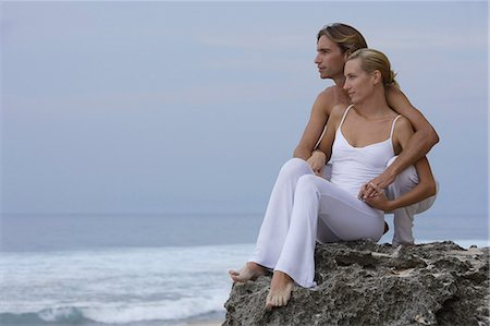 couple on rocks on seashore Stock Photo - Premium Royalty-Free, Code: 6106-06310440