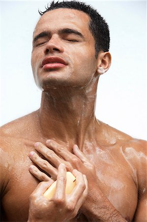 Man in the shower Stock Photo - Premium Royalty-Free, Code: 6106-06310469