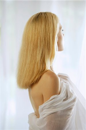 Profile of young woman with blond hair Stock Photo - Premium Royalty-Free, Code: 6106-06310765