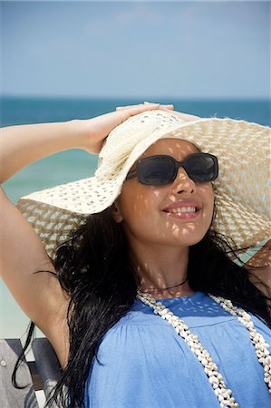 young woman in big sunglasses and hat Stock Photo - Premium Royalty-Free, Code: 6106-06310842
