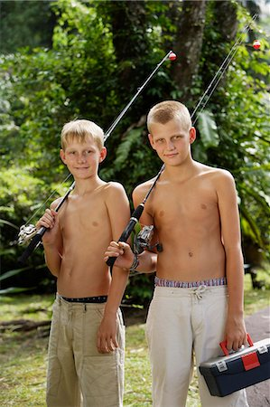 young boys with fishing gear Stock Photo - Premium Royalty-Free, Code: 6106-06310907