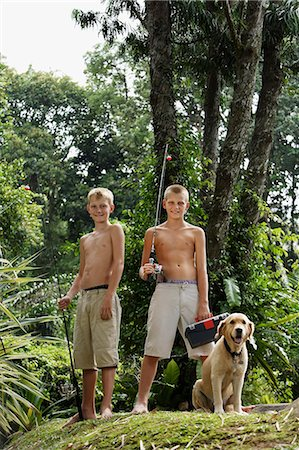 young boys with dog and fishing gear Stock Photo - Premium Royalty-Free, Code: 6106-06310905