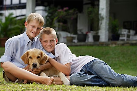two boys with dog Stock Photo - Premium Royalty-Free, Code: 6106-06310921