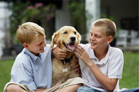 two boys with dog Stock Photo - Premium Royalty-Free, Code: 6106-06310922