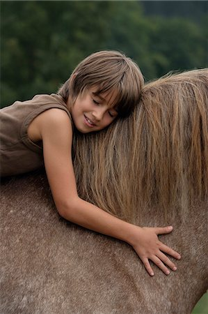 boy on horseback Stock Photo - Premium Royalty-Free, Code: 6106-06311307