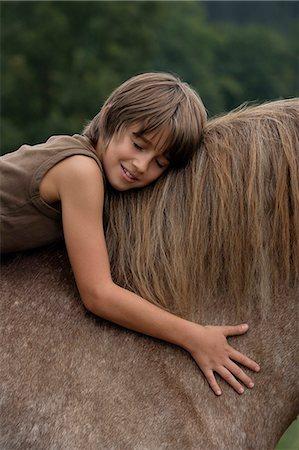 boy on horseback Stock Photo - Premium Royalty-Free, Code: 6106-06311307