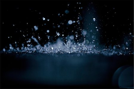 Splashing water droplets Stock Photo - Premium Royalty-Free, Code: 6106-06311551