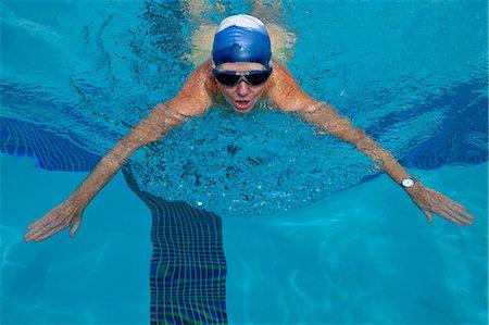 seniors and swim cap - Mature woman excercising in pool Stock Photo - Premium Royalty-Free, Code: 6106-06311580