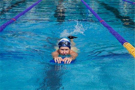 seniors and swim cap - Mature woman excercising in pool Stock Photo - Premium Royalty-Free, Code: 6106-06334853