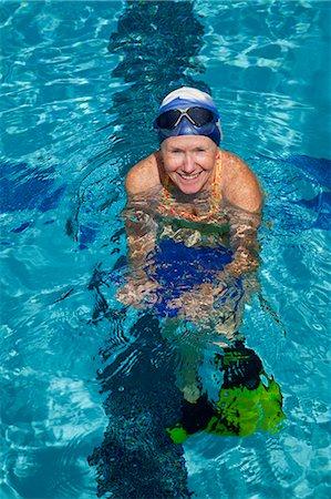 seniors and swim cap - Mature woman excercising in pool Stock Photo - Premium Royalty-Free, Code: 6106-06334854