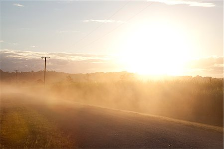 roads and sun - Sun flare on  Australian country road landscape Stock Photo - Premium Royalty-Free, Code: 6106-06334838