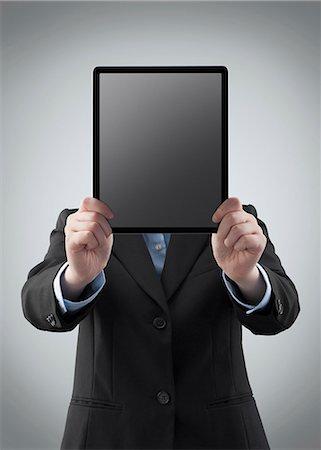 futuristic - Businesswoman holding a digital tablet Stock Photo - Premium Royalty-Free, Code: 6106-06334977