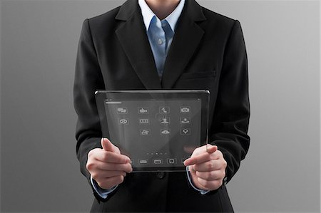 showing - Woman holding a futuristic digital tablet Stock Photo - Premium Royalty-Free, Code: 6106-06334983