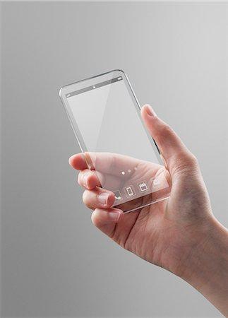 female hand - Woman holding a futuristic smartphone Stock Photo - Premium Royalty-Free, Code: 6106-06334980