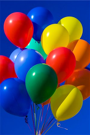 Colorful balloons against blue sky Stock Photo - Premium Royalty-Free, Code: 6106-06334939