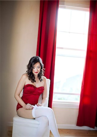 red chair - Woman in red Stock Photo - Premium Royalty-Free, Code: 6106-06335023