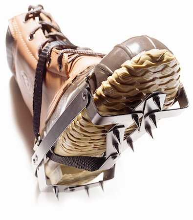 spike - A pair of winter boots fitted with crampons Stock Photo - Premium Royalty-Free, Code: 6106-06335304