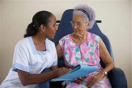 Nurse Assisting Senior Stock Photo - Premium Royalty-Free, Code: 6106-06335961