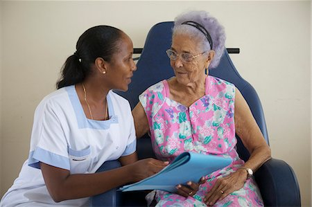 Nurse Assisting Senior Stock Photo - Premium Royalty-Free, Code: 6106-06335961