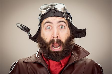 surprised - old style scared pilot portrait Stock Photo - Premium Royalty-Free, Code: 6106-06495960