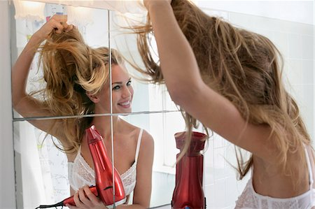 dry - woman in bathroom and hair Stock Photo - Premium Royalty-Free, Code: 6106-06496232