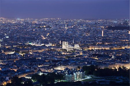 Elevated view of the center of Paris at night Stock Photo - Premium Royalty-Free, Code: 6106-06496932