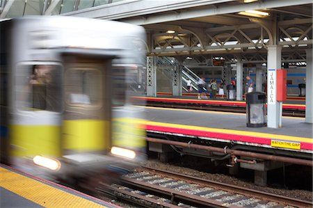 Moving train along platform. Stock Photo - Premium Royalty-Free, Code: 6106-06497075