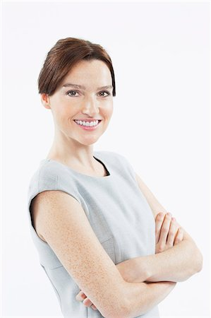 Portrait of smiling businesswoman with arms folded Stock Photo - Premium Royalty-Free, Code: 6106-06497243