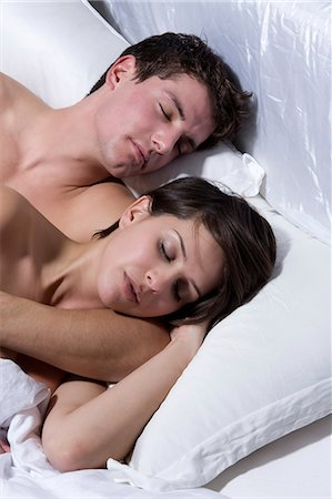 romantic couple bed - Young Couple Sleeping On Bed Stock Photo - Premium Royalty-Free, Code: 6106-06497359