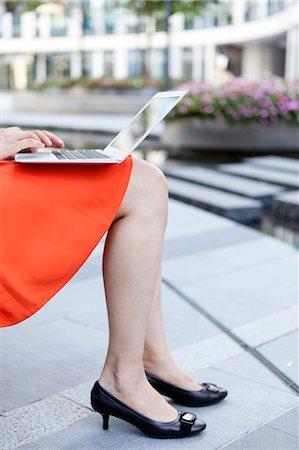 Businesswoman with modern laptop Stock Photo - Premium Royalty-Free, Code: 6106-06497328